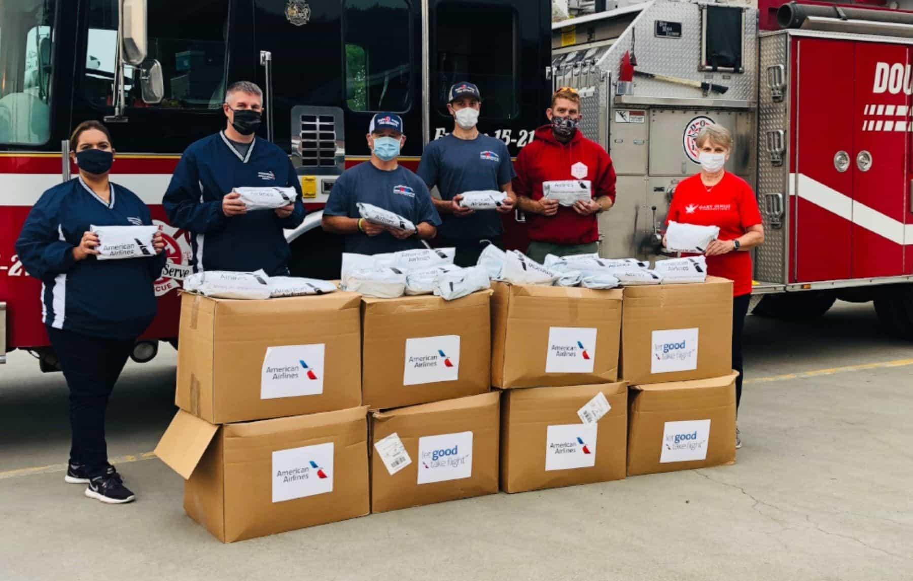 American Airlines and the Gary Sinise Foundation deliver snack care packages to firefighters in Brewster, Washington, during a three-state West Coast tour.