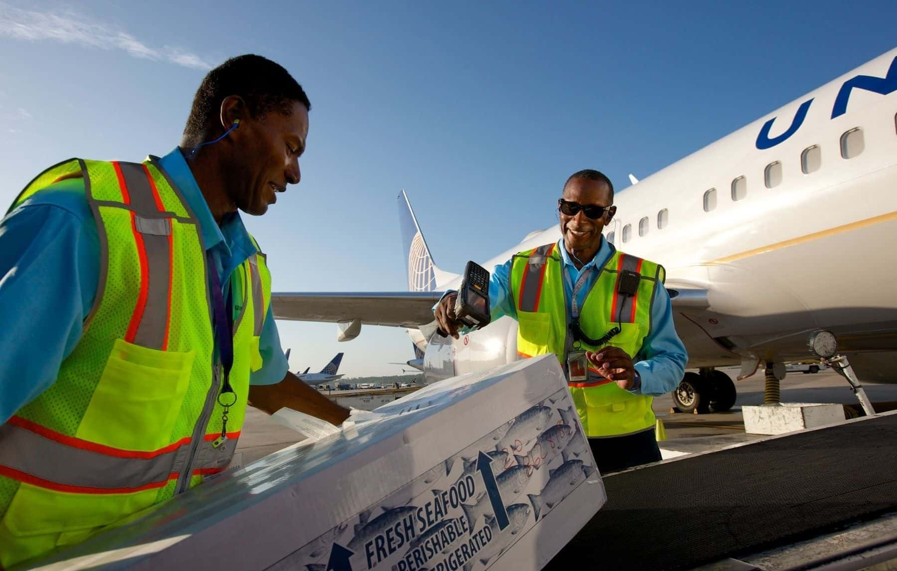 United Airlines employees loading cargo